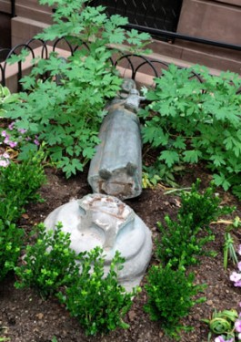 A statue of Mary outside St. Charles Borromeo Church was the victim of vandals.