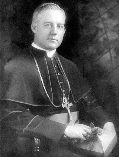 Archbishop Thomas E. Molloy, a native of Nashua, N.H., graduated from St. Francis College, Brooklyn, and was ordained a priest in Rome on Sept. 19, 1908... served as secretary to Bishop Mundelein, a member of the faculty of Cathedral College, Brooklyn, secretary to Archbishop Mundelein in Chicago, and president of St. Joseph's College for Women, Brooklyn... appointed the second auxiliary bishop of Brooklyn on July 28, 1920... appointed the third Ordinary of the Diocese of Brooklyn on Nov. 21, 1921, and served until his death in 1956.  He is buried in the crypt at Immaculate Conception Seminary, Huntington, L.I.
