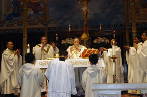 Archbishop Bernardino Auza and priests from St. Sebastian Church, Woodside, during the eucharistic consecration at a Aug. 2 Mass.