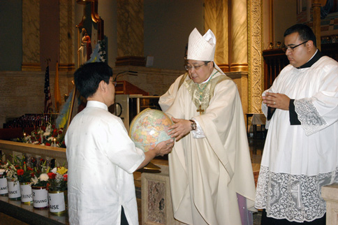 Archbishop Bernardino Auza, permanent observer of the Holy See to the United Nations, receives a globe symbolizing God the Father's constant care for all creation at St. Sebastian Church, Woodside. (Photos by Maria-Pia Negro Chin)
