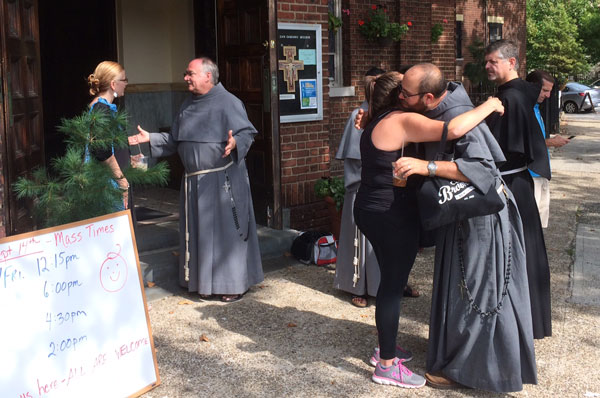 Conventual Franciscan friars greet the residents of the Greenpoint/ Williamsburg, shortly after they opened their San Damiano Mission in the neighborhood, which had been the Holy Family (Slovak) Church. Photo © Ed Wilkinson