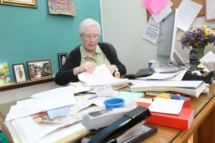Sister Margaret reviews paperwork in her office at St. John the Evangelist Church, Riverhead, L.I. (Photo by Gregory A. Shemitz)