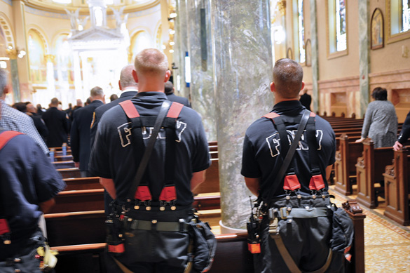 They processed through the streets of Brooklyn to St. Joseph's Co-Cathedral, where a memorial Mass was celebrated by the rector, Msgr. Kieran Harrington. (Photo by Ed Wilkinson)