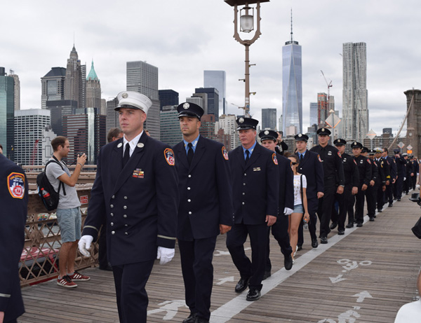 Firefighters from Battalion 57 march across the Brooklyn Bridge following 9/11 ceremonies at ground zero. (Photos by Maria-Pia Negro Chin)