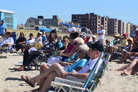 St. Francis de Sales parish celebrated the end of summer with a Sunday Mass on the beach. Parishioners prepare for the liturgy.