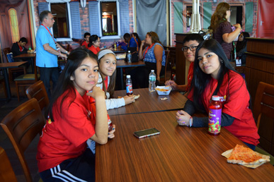 Youth from Our Lady of Mt. Carmel, Astoria, have lunch at the convention center's cafeteria before attending the World Meeting of Families' Youth Congress.