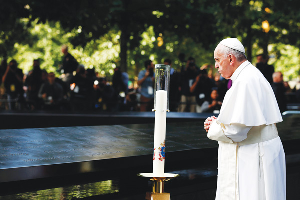 Pope Francis pauses to pray at the south pool of the National 9/11 Memorial and Museum in Lower Manhattan Sept. 25. (Photo © Catholic News Service/Jin Lee, pool)