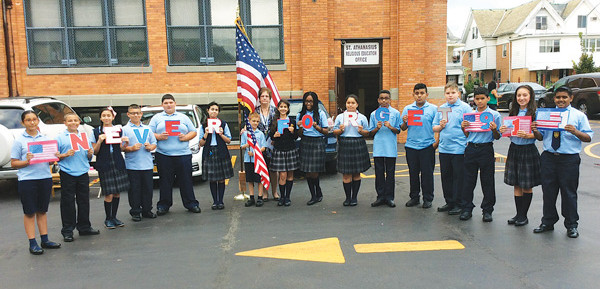 "On Sept. 11, the students of St. Athanasius School, Bensonhurst, under the direction of their principal, Diane Competello, held a remembrance ceremony to honor those who lost their lives on 9/11/01. The eighth-grade students reflected on the tragic events of that day by creating an acrostic poem, ""Never Forget 9/11."" In addition, the students also remembered those who succumbed to 9/11-related illnesses and those who are continuing to battle 9/11-related diseases. The ceremony concluded with the students praying and singing ""God Bless America."""