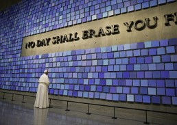 "Pope Francis pauses in front of a display at the National 9/11 Memorial and Museum in New York Sept. 25. The Virgil quotation on the wall reads, ""No day shall erase you from the memory of time."" (CNS photo/Paul Haring)"