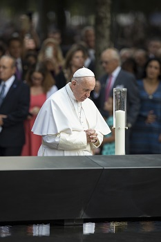 Pope Francis prays at the South Pool of the National 9/11 Memorial and Museum Sept. 25 in New York. (CNS photo/Rick Musacchio, Tennessee Register) .
