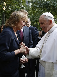 Pope Francis greets a woman at the National 9/11 Memorial and Museum in New York Sept. 25. During his visit to the memorial, Pope Francis spoke about tears and quenching the world's longing for peace. (CNS photo/Paul Haring)