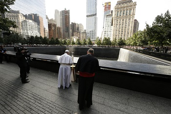 Pope Francis prays at the ground zero 9/11 Memorial in New York Sept. 25. (CNS photo/Paul Haring)