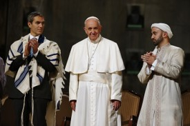 Pope Francis stands with Rabbi Elliot J. Cosgrove (left) and Iman Khalid Latif (right) at a interreligious gathering at the the 9/11 Memorial Museum in New York Sept. 25. The pope visited the former World Trade Center site as part of his six-day trip to the United States. (CNS photo/Jin Lee, pool)