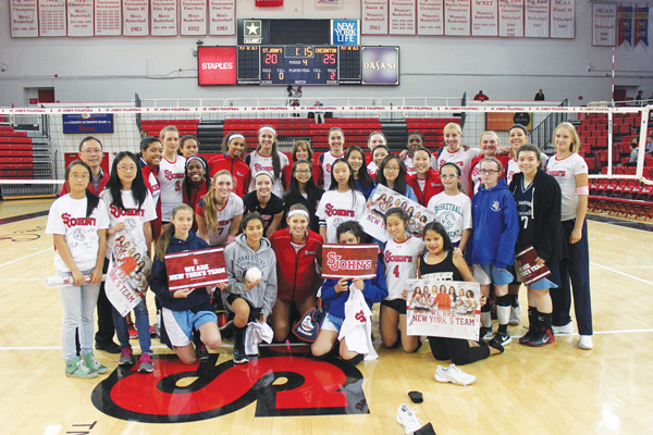 Members of local Catholic Youth Organization volleyball teams were welcomed by the St. John's Division I volleyball team. Photos © Jim Mancari