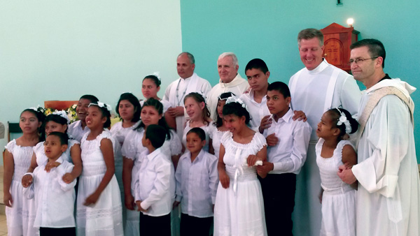 Father Mark Matthias, second from right, from Our Lady of the Blessed Sacrament parish, Bayside, poses with First Communicants at the Mustard Seed Community in Nicaragua.