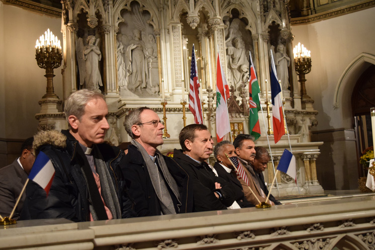 Religious leaders sit together before the altar at St. Agnes Church during an interfaith prayer service held in response to the terror that struck Paris.