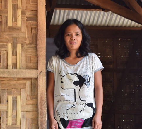 Nady Biay is a farmer who benefited from CRS livelihood training. She also raises native chicken and a pig to support her family.