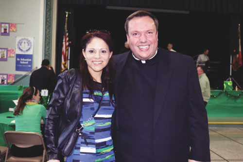 Father Kevin Abels, pastor, and Alma Mendez, administrative assistant, at St. Sebastian's, helped lead the Generations of Faith campaign in the parish.