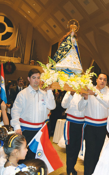 Paraguayan men carry a replica of the image of Our Lady of the Miracles of Caacupé as they process into Our Lady of Fatima Church, Jackson Heights.