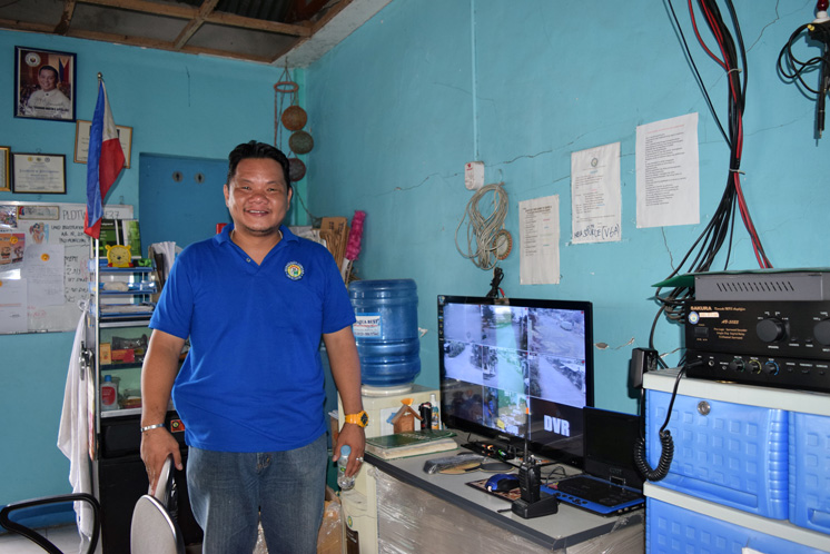 Andres Sevilla, barangay captain in Luntad, shows the town's new emergency response equipment.