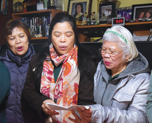 After a Simbang Gabi Mass, choir members of Ascension Church in Elmhurst went to sing Christmas carols in Woodside.