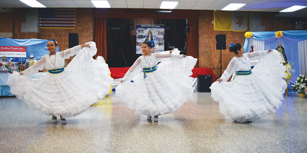 """Members of the """"Grupo Junior Parani"""" perform a dance in honor of the Virgin Mary, whose feast day is on Dec. 8."""