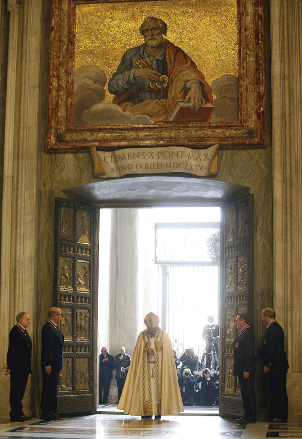 Pope Francis prays after walking through the Holy Door to inaugurate the Jubilee Year of Mercy in St. Peter's Basilica at the Vatican Dec. 8. (Photo © Catholic News Service/ Alessandro Bianchi, Reuters)