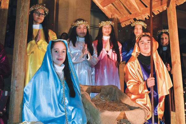 Our Lady of Fatima School's sixth, seventh and eighth graders participated in a Nativity Scene presentation on Dec. 5. (Photos © Maria-Pia Negro Chin)