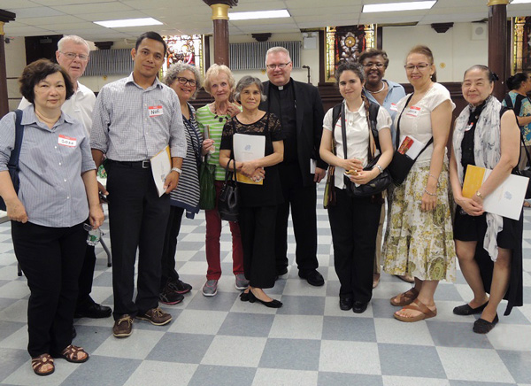 Father Richard Beuther, pastor of St. Bartholomew's parish, Elmhurst, is shown with his Generations of Faith Campaign team that helped push the Queens parish far over its goal. Second from left is parochial vicar Father John Gildea.
