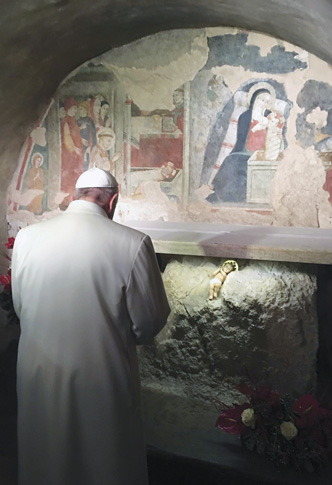 Pope Francis prays in front of a Nativity scene during a Jan. 4 surprise visit to the Franciscan shrine in Greccio, Italy. ( Photo © Catholic News Service/ L'Osservatore Romano)