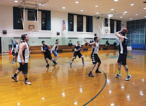Members of the Cathedral Basketball League have been able to stay in touch with their school while playing some competitive hoops. (Photo © Jim Mancari)