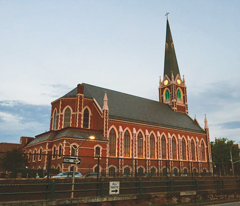 Marking the 150th year of St. Stephen's Church in Carroll Gardens, the now combined parish of Sacred Hearts-St. Stephen church building has stood across the street of the lowered BQE since before the construction of the expressway.
