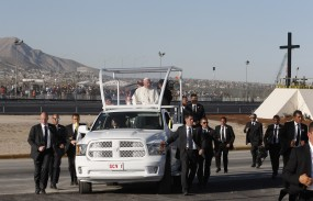 Pope Francis waves from the popemobile after praying at a cross on the border with El Paso, Texas, in Ciudad Juarez, Mexico, Feb. 17. (CNS photo/Paul Haring)