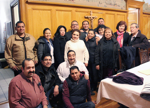 Members of the diocesan Mexican ministry gather with Father Jorge Ortiz, back row, fourth from left, met recently to make plans for the Feb. 6 Mass to pray for the pope's intentions in Mexico. (Photo © Marie Elena Giossi)