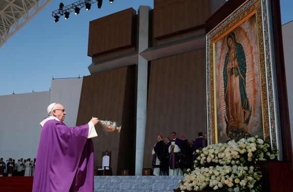 Pope Francis uses incense to venerate an image of Our Lady of Guadalupe during Mass in Ecatepec near Mexico City Feb. 14. (Photo © Catholic News Service/Paul Haring)