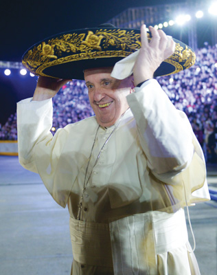 Pope Francis wears a sombrero during his arrival to Mexico City Feb. 12. The Holy Father spent five full days in Mexico, addressing the role of bishops, encouraging religious men and women, urging attention to family life, while touching on the topics of immigration and violence of the drug trade. (Photo © Gustavo Camacho, via Reuters)