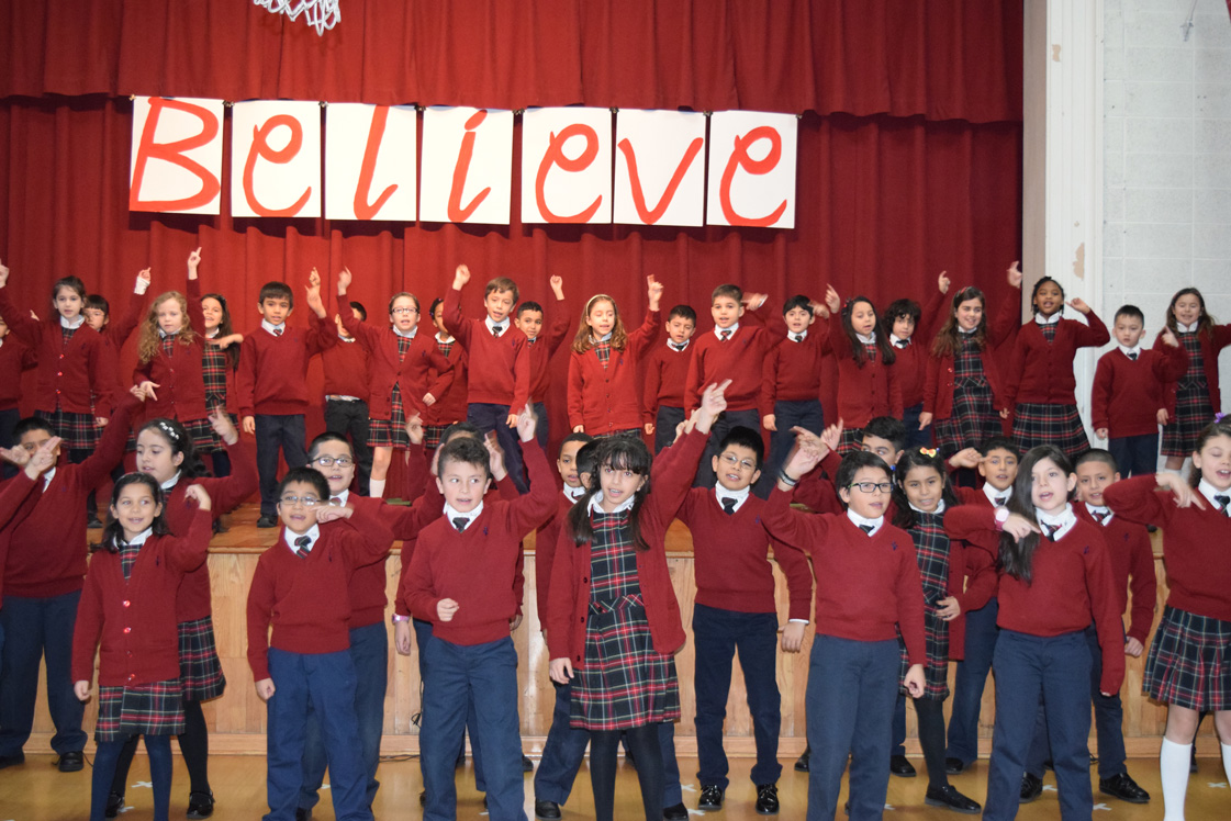 "About 150 students from the school's Spanish Club took the stage to sing and dance ""La Bamba"" in front of Bishop DiMarzio, who visited the school during Catholic Schools Week."