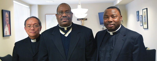 From left, Fathers Anacleto S. Asebias, Jr., Jean G. Laguerre and Francis Kwame Asagba were summoned to the diocesan office two days before their incardination. They are now officially part of the clergy of the Diocese of Brooklyn. Photo © Antonina Zielinska