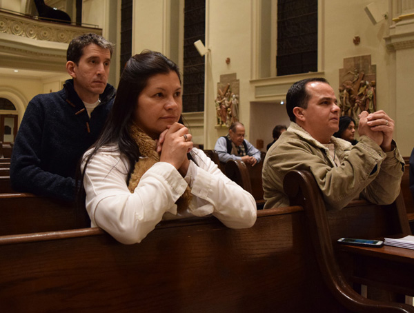 """Parishioners pray in front of the Blessed Sacrament during """"24 hours for the Lord."""""""