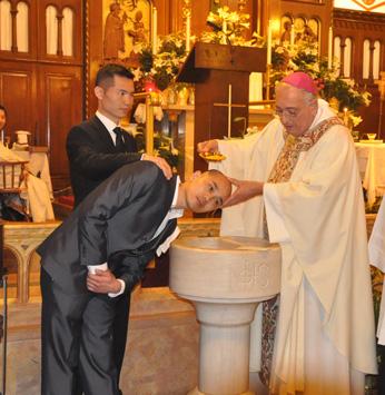Bishop-baptizes-Chinese-man