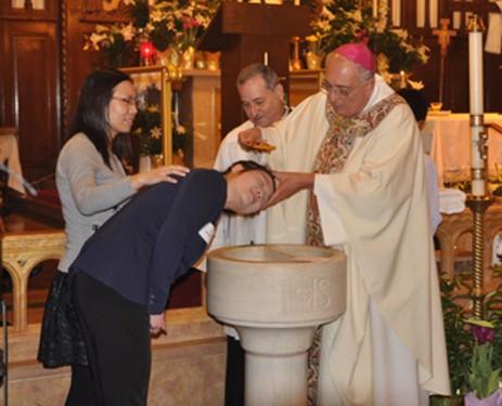 Bishop-baptizes-Chinese-woman-2-slider