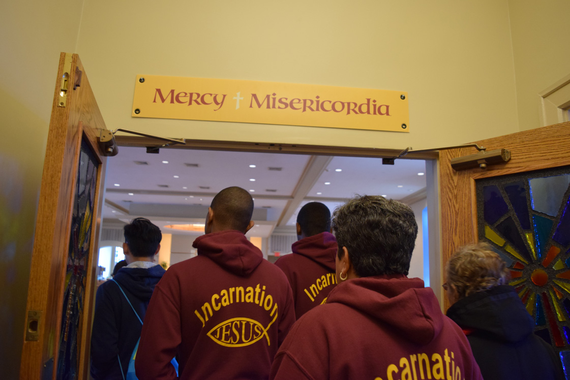 A special moment of this year's Caminata (walk) was the visit to one of the six designated Holy Doors in the diocese, where pilgrims can receive indulgences during the Jubilee of Mercy. Around 460 people participating in the Caminata went through the Holy Doors at the Shrine Church of St. Gerard Majella, Hollis.