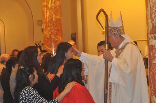 bishop-confirms-tall-Spanishj-girl