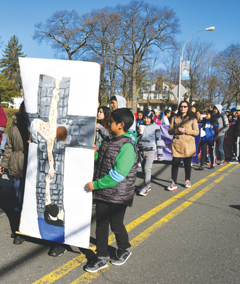 """Jornadistas from parishes in six different zones of the Diocese of Brooklyn and Manhattan journeyed the streets of Jamaica carrying banners reflecting this year's slogan: """"Let us fall into the hand of God, for His mercy is great"""""""