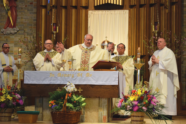 p Bishop Nicholas DiMarzio joined Father Casper Furnari, to his right, and visiting priests for the 75th anniversary Mass at Holy Family Church in Fresh Meadows.