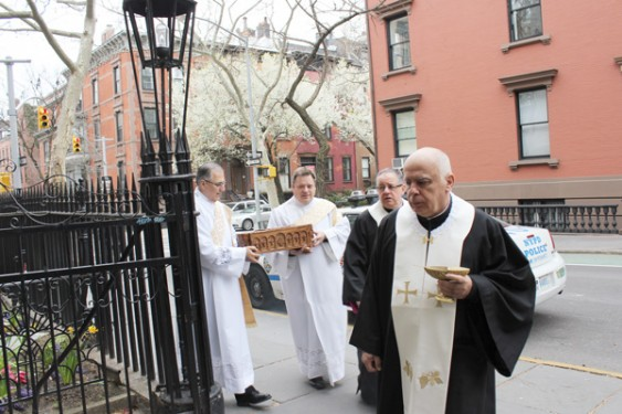 Father Michel Lahoud leads the procession of the relics of St. Sharbel into Our Lady of Lebanon Maronite Cathedral, Brooklyn Heights, April 9. Following Father Lahoud, from right to left, is Msgr. James A. Root, cathedral rector, and carrying the reliquary, Subdeacon Norbert Vogl and Subdeacon-Deacon Candidate Peter Frangie.