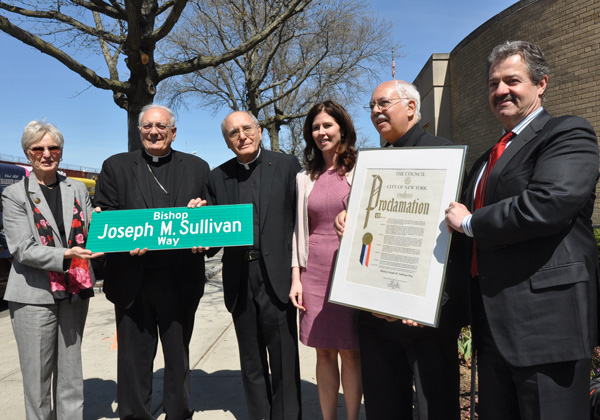 At dedication ceremony for the new Bishop Joseph M. Sullivan Way were, from left, Fran Sullivan, the bishop's sister; Bishop Nicholas DiMarzio; Father Michael Carrano, pastor of Our Lady of Hope; City Council Member Elizabeth Crowley; Father Robert Armato, moderator of the parish's Holy Name Society; and Robert Leavy, president of the Holy Name Society.