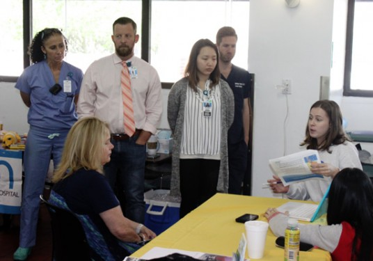 p Swim Strong Foundation intern Emily Tavcar, seated holding paper, leads a presentation during the fourth annual Water Safety Awareness Day at the Brooklyn Sports Club on May 14. (Photo: Jim Mancari)
