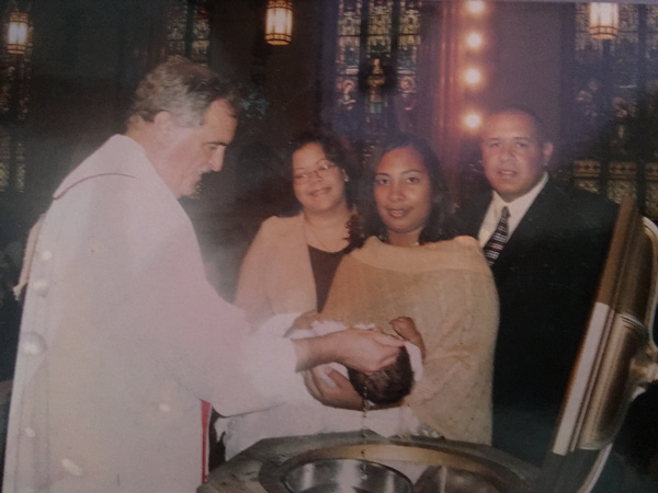 Then-Father Neil Tiedemann baptizes Ileanna Florentino's daughter in 2004. (Photo courtesy Ileanna Florentino)