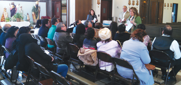 Spanish-speaking parishioners at Our Lady of Mount Carmel gather for information session about Generations of Faith.